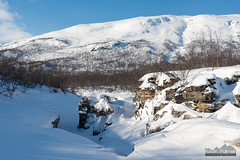 Cliffs and Drifts (kevin-palmer) Tags: abisko abiskocanyon sweden swedishlapland europe arctic nikond750 tamron2470mmf28 abiskoriver snow snowy ice icy frozen birchtrees clouds nuolja march winter blue sky afternoon scandinavianmountains cliffs