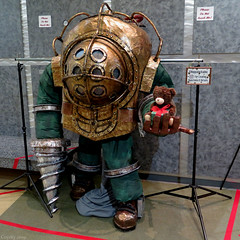 Big Daddy (Coyoty) Tags: barnesfranklingallery tunxiscommunitycollege farmington connecticut ct college art gallery cosplay costume bioshock game videogame character fun square squareformat bigdaddy display exhibit divingsuit teddybear bear toy teddy drill colors copper green gray red