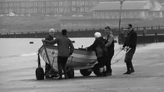 Time to Launch 02 (byronv2) Tags: peoplewatching candid street blackandwhite blackwhite bw monochrome portobello edinburgh edimbourg scotland beach sea northsea river riverforth rnbforth firthofforth forth coast coastal shore boat rowboat skiff sailing rowing water