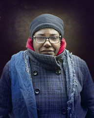 Evette (mckenziemedia) Tags: jacket scarf outerwear warmclothing coat knithat stockingcap wintercoat eyeglasses overcoat homeless homelessness woman beautiful portrait portraiture face chicago city urban streetphotography street