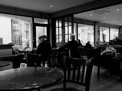 through the window 1 (watcher330) Tags: carmarthen men table window cafe