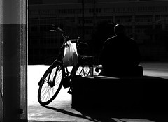 Serious Thoughts (YIP2) Tags: people candid street pavement outdoor black monochrome bw bike bicycle light shadow cyclist
