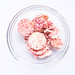 Top view of pink raspberry mini rice cakes in a bowl