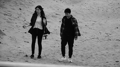 Seaside Strolling 07 (byronv2) Tags: edinburgh edimbourg scotland sea seaside coast coastal peoplewatching candid street walking water river rnbforth firthofforth riverforth forth portobello blackandwhite blackwhite bw monochrome woman man asian