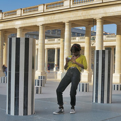 Photographer in precarious balance between the columns (pivapao's citylife flavors) Tags: paris france girl louvre beauties photographer architecture