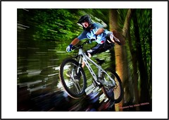 Woosh (Alun Wales) Tags: mountainbikes fillflash zooming slowshutter canon20d