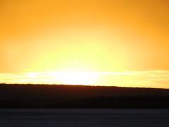 .....nochmal Gas geben.... (elisabeth.mcghee) Tags: sonnenuntergang sunset abendhimmel landschaft landscape winter wintersonne winterlandschaft schneelandschaft snow schnee himmel sky clouds wolken orange wald forest bäume trees