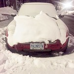 PALMRSTN, a red Volkswagen Beetle in snow thumbnail