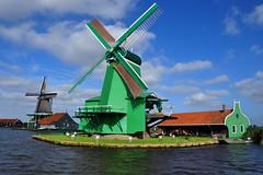 Windmills in Zaanse Schans, Netherlands (natureloving) Tags: windmills zaanseschans netherlands holland amsterdam europe nature water travel landscape natureloving nikon d90 nikonafsdxnikkor18300mmf3563gedvr