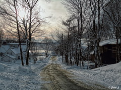 Le droit chemin (Jean S..) Tags: street sunset trees island house sky clouds snow winter river water landscape