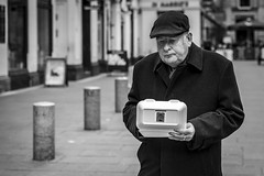 Fish and Chips (Leanne Boulton) Tags: urban street candid portrait portraiture streetphotography candidstreetphotography candidportrait streetportrait streetlife sociallandscape old elderly man male face eyes expression feeling mood emotion food fastfood fishandchips cap coat polystyrene takeaway carryout tone texture detail depthoffield bokeh naturallight outdoor light shade city scene human life living humanity society culture lifestyle people canon canon5dmkiii 70mm ef2470mmf28liiusm black white blackwhite bw mono blackandwhite monochrome glasgow scotland uk