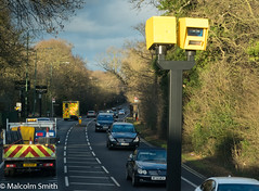 Big Brother (M C Smith) Tags: pentax k3 speedcamera yellow traffic cars van trees green red black signs letters numbers busstop busshelter bin cones ambulance bins busstops busshelters lines arrow white forest lights silver blue