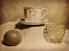 Bone China Cup and Saucer, Cubist Glass Cream Pitcher and a Tangerine (N.the.Kudzu) Tags: tabletop stilllife bonechina coffee cup cubist glass pitcher tangerine canoneosm lensbabytrio28 2lilowls lightroom preset photoscape texture sepia