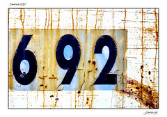 District 692 (Danial Thiessen) Tags: seven six photography abstract abstractphotography abstractart abandoned forgotten sony rx10iii rx10m3 rust rusted rusty weathered numbers 692 nine two blue orange white closeup close macro art artistic lines
