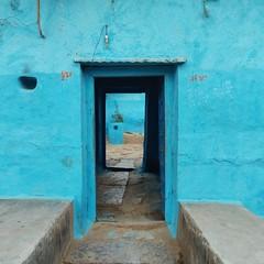 Modest Ingenuity. (Gattam Pattam) Tags: wall architecture houses village chhattisgarh india rural blue street door entrance walk mud earth threshold