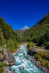 The Mountain and the River (Anderson Porfírio - Fotografia) Tags: trekking trek river sky bluesky moutain landscape landscapes trees forest rocks asia nepal everestregion scenic idyllic