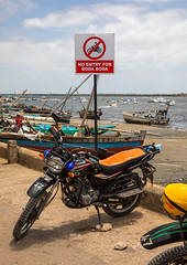 Boda boda motorbikes taxi on the port, Lamu county, Lamu town, Kenya (Eric Lafforgue) Tags: africa billboard boats bodaboda colourpicture day developement dhows eastafrica forbidden horizontal kenya lamu lamuisland motorbike noisy outdoors photography pollution road sign taxi transportation traveldestination unescoworldheritagesite worldheritagesite lamutown lamucounty ke