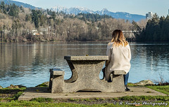 Thinking (R. Sawdon Photography) Tags: rockypointpark portmoody metrovancouver bench girl concrete water ocean burrardinlet mountains grass park lonley shoreline trees