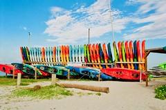 Colorful Kayaks (The Vintage Lens) Tags: colors kayaks bluw skies beach gulf florida