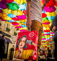 Street - Shop whenever you want (François Escriva) Tags: street streetphotography paris france people candid olympus omd photo rue colors sidewalk umbrellas shade village royal man ride blue red orange green purple passage yellow bag errands shop fun funny ca