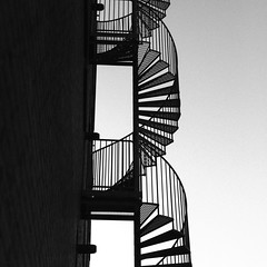 Fire Escape (Mabry Campbell) Tags: europe malmö scandinavia skane skåne sweden architecturephotography blackandwhite building exterior fineartphotography fireescape image malmo photo photograph photography spiral squarecrop stairs sverige f50 mabrycampbell february 2012 february252012 201202252361 50mm ¹⁄₁₂₅₀sec 100 ef50mmf14usm