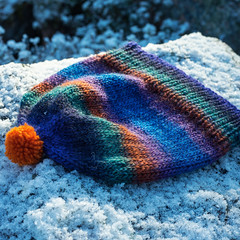 Hat with orange pom pom (Winterbound) Tags: knitting handmade handknitted hat pompom winter