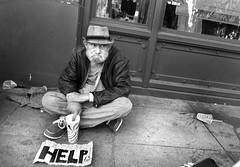 5th Street - San Francisco, CA (Rex Mandel) Tags: homeless sanfrancisco downtown unionsquare sf blackandwhite bw monochrome street streetphotography hat spilleddrink sidewalkstains olderhomeless sign streetperson sidewalk