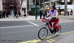 `2498 (roll the dice) Tags: london westminster westend w1 mad sad fun funny smile happy reaction streetphotography cold surreal girl pretty sexy people fashion weather angry shock canon tourism tourists colour portrait strangers candid urban unaware unknown uk classic crowd busy bored eyes face tfl santander bicycle legs traffic selfridges oxfordstreet gucci crossing window