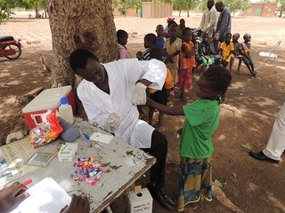 Health Worker Checks Child for LF in Burkina Faso by