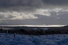 Views over Irvine Bay (Liam Waddell) Tags: snow ice trees bushes poles clouds sky kilwinning stevenston scotland ayrshire irvine bay water