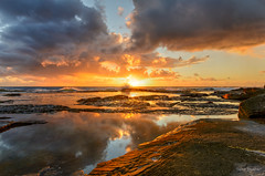 The flames of dawn (JustAddVignette) Tags: australia clouds dawn deewhy flamingsky landscapes newsouthwales northernbeaches ocean orange reflections risingtide rocks seascape seawater sky sunrays sunrise swell sydney water waves