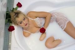 Milky way of showing her sexiness (piotr_szymanek) Tags: ania aniaz studio portrait face eyesoncamera bath milkbath bathroom blonde transparent lingerie flower rose legs 1k 20f 50f 5k 10k 100f