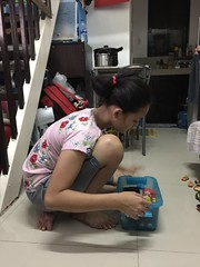 Ashley is cleaning up Herou's toy box (ghostgirl_Annver) Tags: asia asian girl ashley teen daughter sister family beautiful toy box