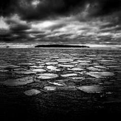Baltic sea (Samuli Koukku) Tags: finland helsinki lauttasaari balticsea bw blackwhite filmphotography film ilford hp5 mediumformat 6x6 hasselblad 500cm 50mm distagon sea seascape winter landscape melkki cloud shore ice nature naturephotography