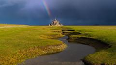 Divine Providence (carolina_sky) Tags: montsaintmichel france normandy rainbow river curve grassland pasture cloudy stormy rain mountain abbey pentaxk1 pentax1530mm pixelshift skymatthewsphotography