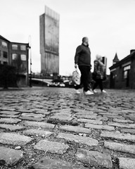 Manchester cobbles (bitrot) Tags: architecture bw beethamtower blackandwhite building buildings castlefield cobbles manchester pedestrian pedestrians people shopping skyscraper street tower lightroom lightroom8 canoneos5dmarkiii ef24105mmf4lisusm 24mm f40 1200sec iso100