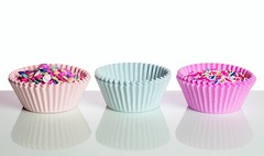 Candy Cups (Karen_Chappell) Tags: candy springles paper pastel birthday holiday white pink blue stilllife product reflection three 3 candies food sweet