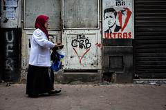 Mohammed Belouizdad street, Algiers (puuuuuuuuce) Tags: algiers algeria woman walking hijab grafitti streetphotography