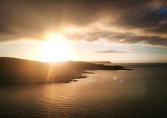 Wednesday Sunset (stewartbaird) Tags: sun summer beach newzealand sunset nature sky plimmerton landscape flare clouds