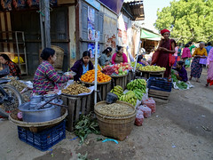 A busier section of the Mani Sithu market in Nyaung U, Myanmar (Claire Backhouse) Tags: myanmar burma nyaungu bagan market markets buying selling shopping agriculture horticulture organic vegetables fruit fresh women working rural baskets bananas apples oranges nuts peanuts