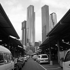 Vanishing Point, Melbourne (little_frank) Tags: vanishingpoint melbourne victoriamarket victoria australia perspective skyline skyscraper blackandwhite blackwhite desaturated composition design style architecture building street exploring converge converging lines geometries cars landmark facade rising vertical tower towering