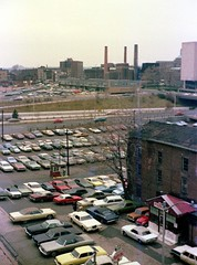 The view from the Temple Street Parking garage toward Route 34 (The Oak Street Connnector). Lots of colorful 1960s and early 1970s cars parked in the street level lot. New Haven Connecticut. Dec 28 1974 (wavz13) Tags: analog vintageanalog oldphotographs oldphotos 1970sphotographs 1970sphotos oldphotography 1970sphotography oldhighways vintagehighways oldroads vintageroads vintagephotography filmphotos filmphotography vintagenewhaven oldnewhaven 1970snewhaven industrialnewhaven newhavenphotography newhavenphotos vintageparkinggarages oldparkinggarages 1970sparkinggarages carphotography carphotos automotivephotography automotivephotos oldcars vintagecars 1960scars 1970scars collectiblecars collectablecars connecticutphotographs connecticutphotos connecticutphotography oldconnecticutphotography oldconnecticutphotos elmcity oldconnecticut vintageconnecticut 1970sconnecticut 110film kodacolor analogphotography instamatic pocketinstamatic vintagecar oldcar oldbuildings vintagebuildings brickbuildings vinylroofs vinylroof