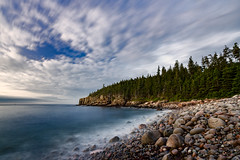 Sunrise on Otter Cliffs from Pebble Beach (The Burgys) Tags: cliffs maine acadia acadianationalpark pebble beach ocean water sunrise trees sky longexposure pebblebeach ottercliffs clouds colors sony sonya99 zeiss1635