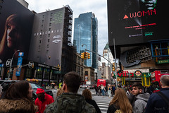 Womn (Jocey K) Tags: sonydscrx100m6 triptocanadaandnewyork architecture buildings street people words signs crowds billboards faces sky clouds