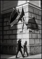 Reval-1 (TK@Pictures) Tags: bnw man shadows flags estonia winter snow reval tallinn monochrom theodorkierdorf m246 leica pedestrian blackandwhite street art medieval city apo 50mm