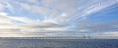 The Øresund or Öresund Bridge is a combined railway and motorway bridge across the Øresund strait between Sweden and Denmark. The bridge runs nearly 8 kilometres (5 miles) from the Swedish coast to the ... two major metropolitan areas: Copenhagen, the Dan (Gerard Knight) Tags: bridge sea sweden denmark