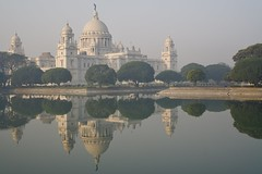 Victoria Memorial (brantliveson) Tags: victoria memorial kolkata india reflection sunrise pond lake clear sky sunlight golden fog architecture landscape ancient old building trees 35mm sony travel explore photography city beautiful pretty nice