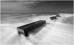Have a seat (Rob Schop) Tags: blackandwhite monochrome beach zeeland noordzee seats motionblur waves sea sonya6000 wideangle samyang12mmf20 hoyaprofilters nd64 pola holland storm f11