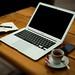 MacBook Air on brown wooden table - Credit to https://myfriendscoffee.com/