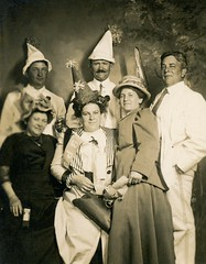 Hearty Partiers (Alan Mays) Tags: ephemera postcards realphotopostcards rppc photos photographs foundphotos portraits studiophotos men women clothes clothing suits ties bowties neckties dresses hats partyhats parties ratchetnoisemakers ratchets noisemakers partiers pennants banners flags masks purses newyear newyears newyearsday january1 bpoe benevolentandprotectiveorderofelks elkslodge elks fraternalorganizations fraternalgroups fraternal clubs organizations groups societies associations blurry flawed antique old vintage vptp noveltystudio seattle wa wash washington photographers studios